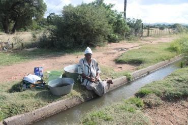 Water from the irrigation canal being used for washing and bathing before reaching the irrigation scheme