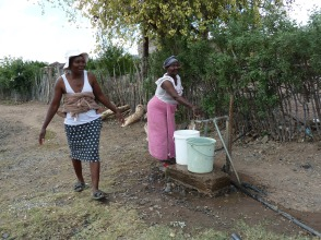 Chatting to women filling up their water buckets